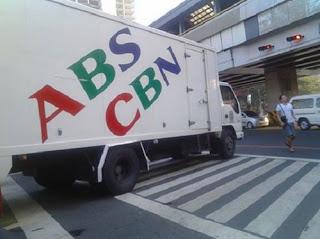 abs-cbn truck on pedestrian crosswalk
