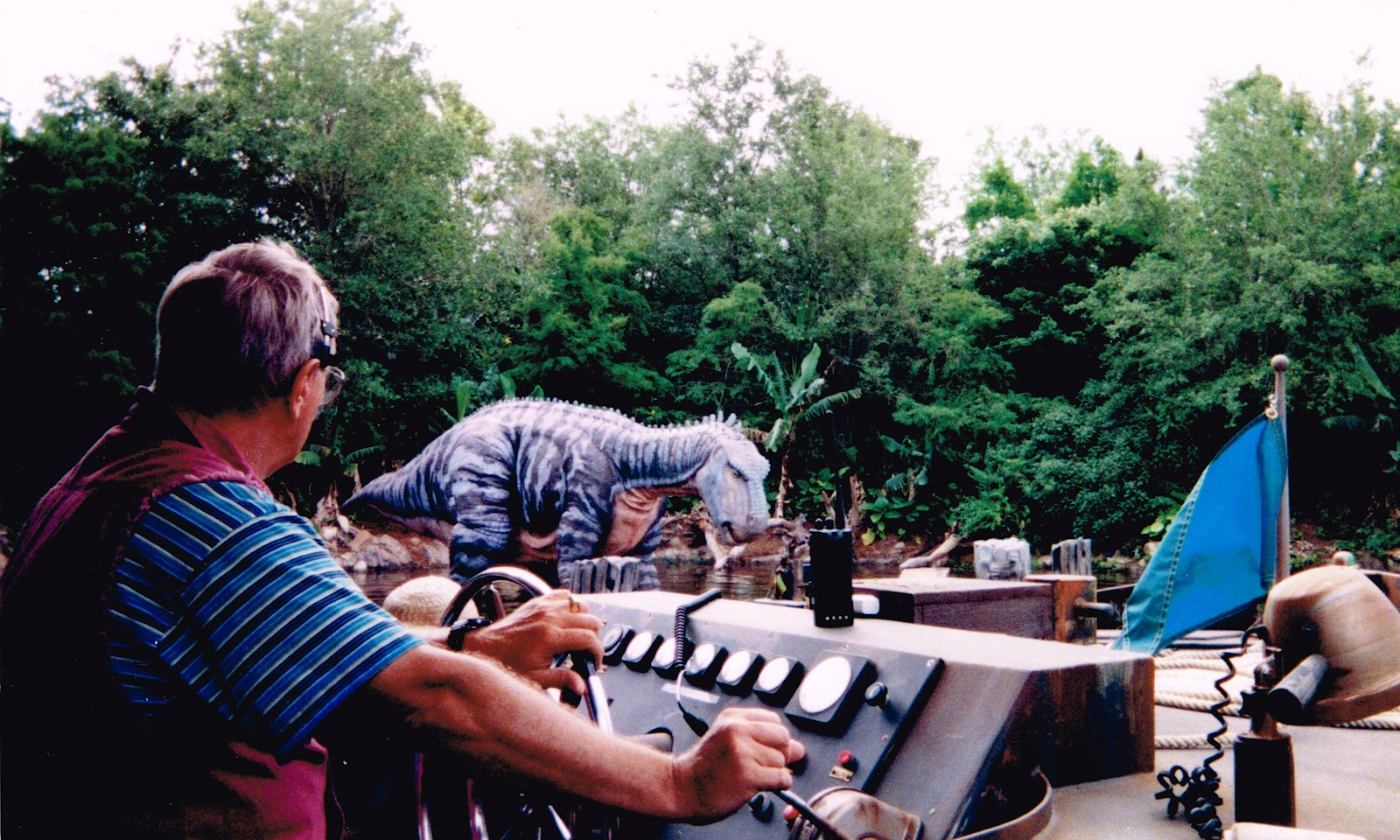 Discovery river boat ride he now sits in front of dinosaur the ride