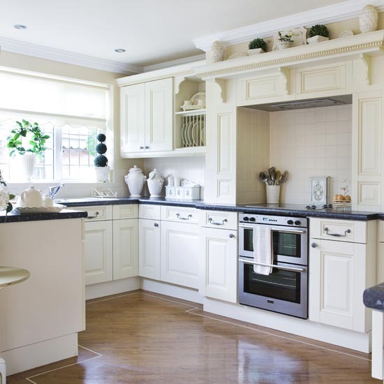 New home interior design more of traditional kitchen for Traditional black and white kitchen designs