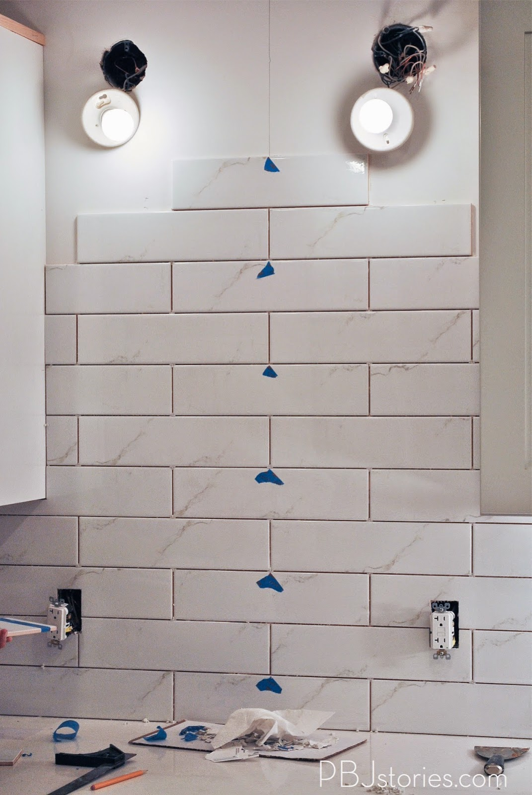 Pbjstories installing subway tile for kitchen backsplash similar to how we cut the outlet tiles we had to cut out the areas for the pendant lights it was a little more difficult since its a curved area dailygadgetfo Gallery