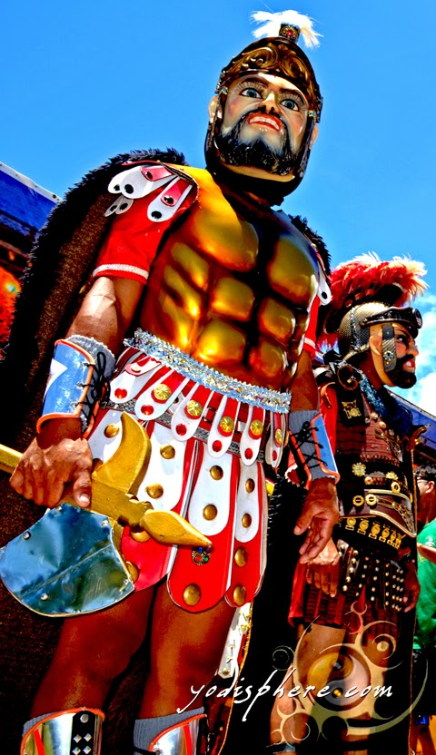 Moriones wearing colorful wooden mask and thick body costume