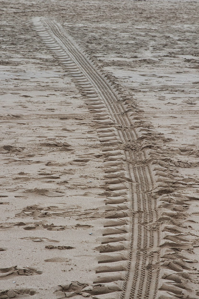 car tracks in sand