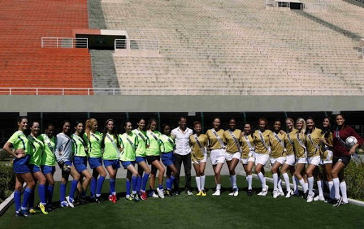 Miss Universe 2011 contestants pose for a picture after playing an exhibition football match