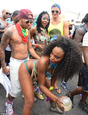 Rihanna & Lewis Hamilton cosy up at Barbados festival  2B16A63B00000578-3184374-image-a-54_1438693857800