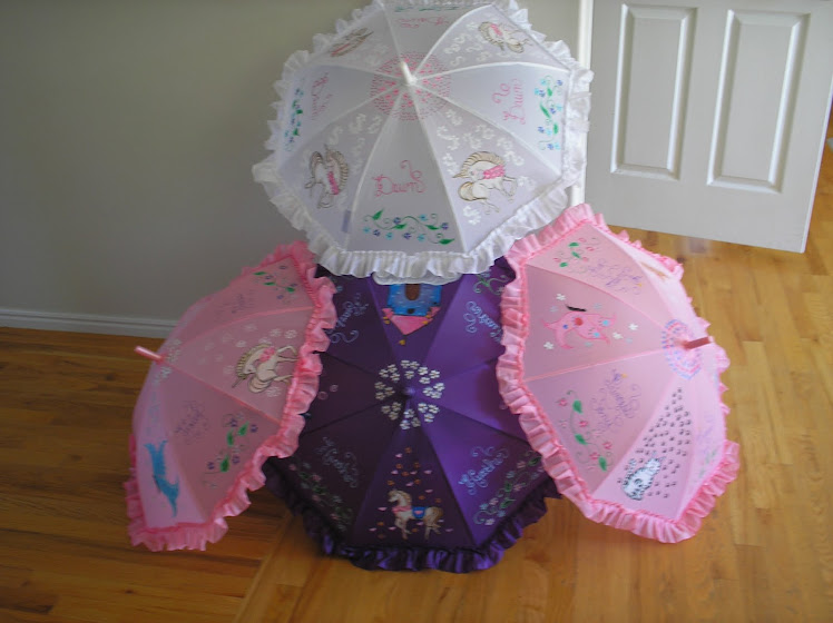pink ,purple and white parasols