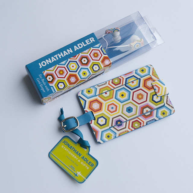 Jonathan Adler luggage tag and earbuds