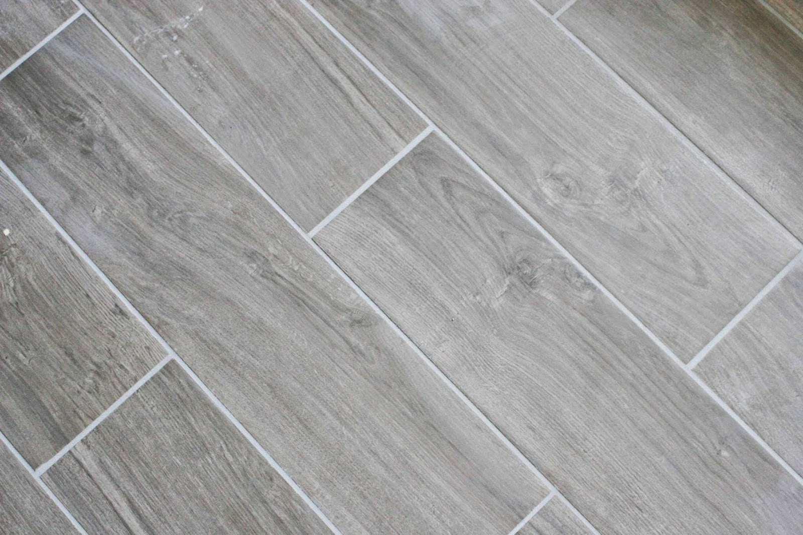 Bathroom renovation tile craftivity designs for Grey wood floor bathroom
