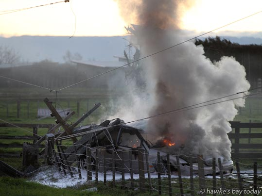 A car smashed a power pole and burst into flames on Te Aute Rd, Pakipaki, about 1650. Witnesses said they saw the car speeding along the road, and the driver getting into another vehicle after the crash. Police, St John Ambulance and the Fire Service attended. photograph