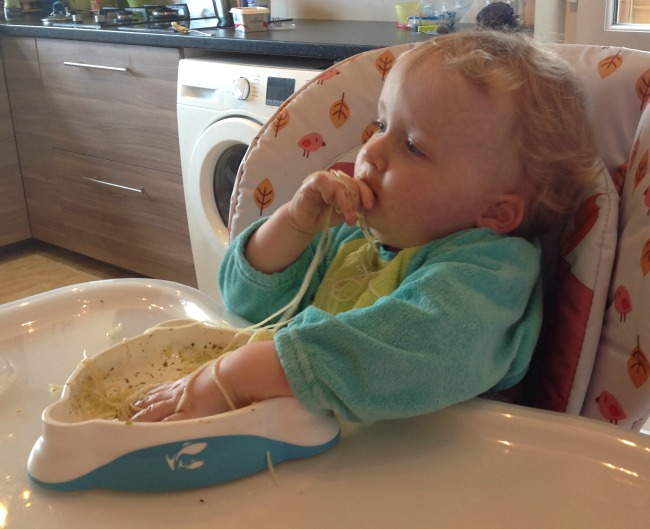 Picture of toddler eating spagetti