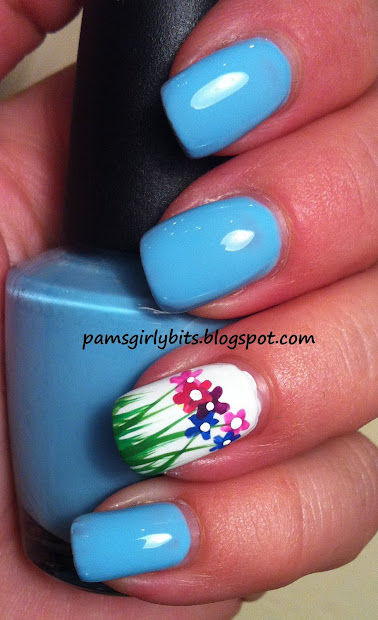 girly bits flowers in grass