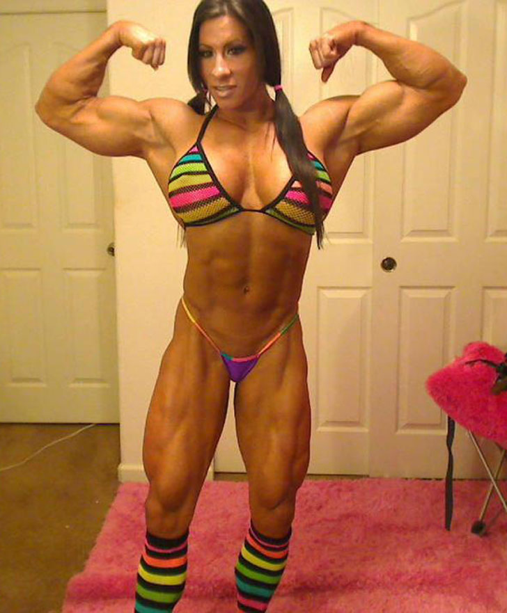 Female Bodybuilder Angela Salvagno Flexing Her Biceps In A Bikini