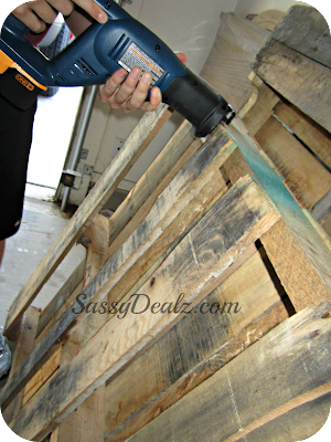 sawing the wood pallet wine rack
