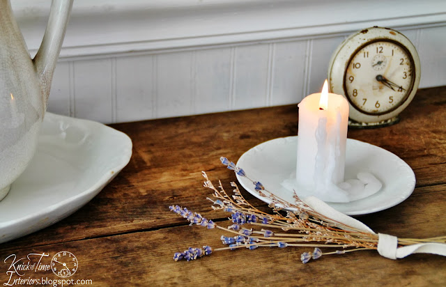 Antique Farmhouse Work Table with Lavender bundle an antique clock and drippy white candle via http://knickoftimeinteriors.blogspot.com/