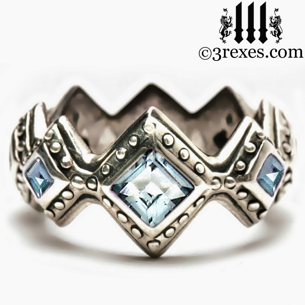 Renaissance silver wedding ring with blue topaz stone
