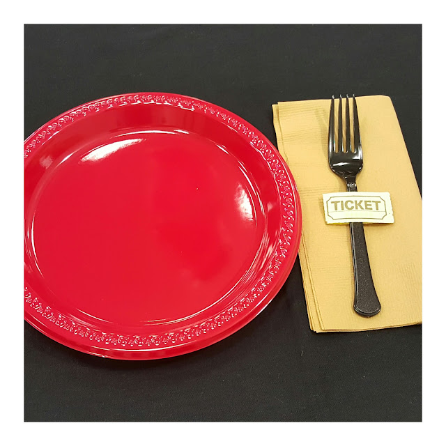 ticket, napkins ring, red plates