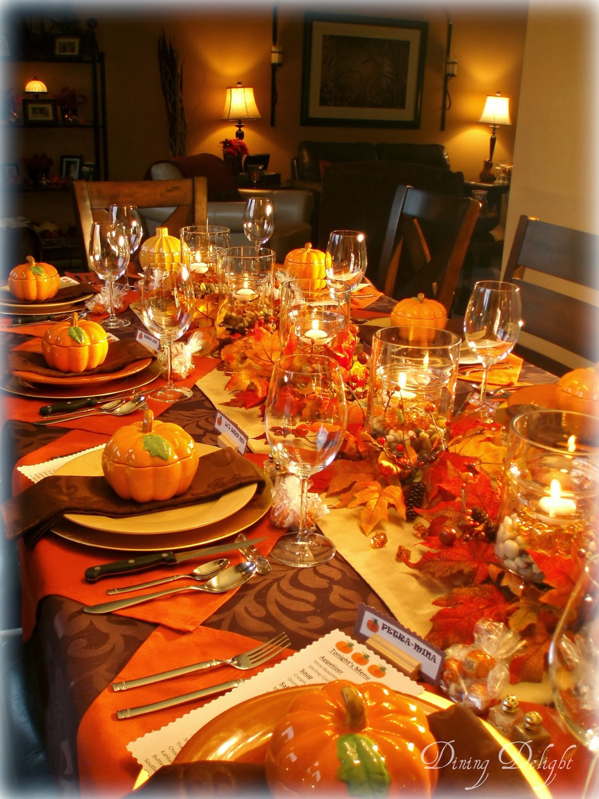 For a show-stopping table setting that honors tradition, fill the center of your table with a colorful display of pumpkins, gourds, nuts, fruits, veggies and seasonal blooms. Carry the bountiful theme to each place setting with an artichoke place card holder. Get more tips for setting a harvest-inspired table.