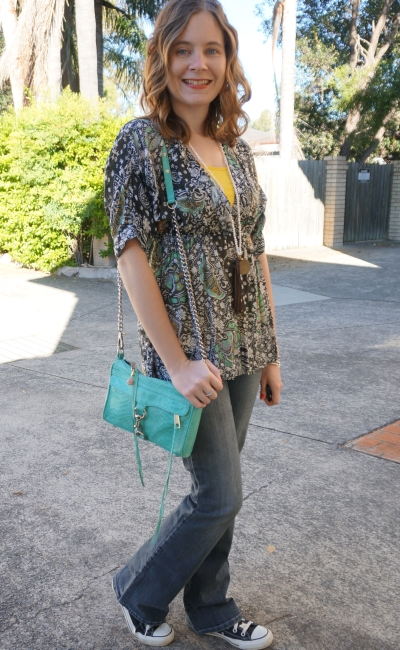 70s inspired paisley print empire waist blouse Converse chucks flared jeans