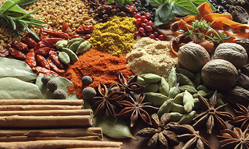 A collage of different foods and spices.