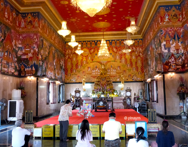 people praying inside the temple