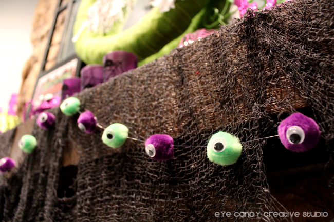 pom poms, how to make eyeball garland, halloween party decor
