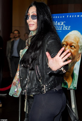 Cher playfully waves at the camera