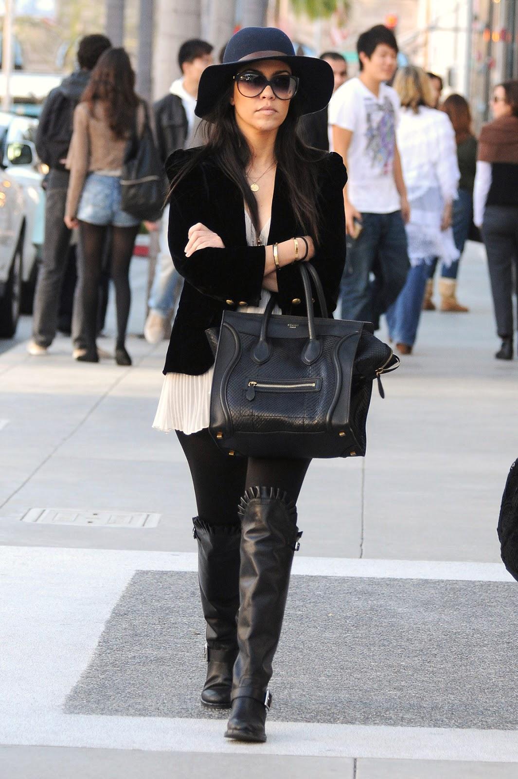 Khloe Kardashian shows off fit figure in skintight dress
