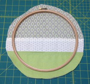 Trim layers to 1'' larger than the hoop
