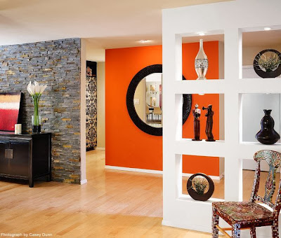 an attractive house entryway with various statues mounted on custom built rack