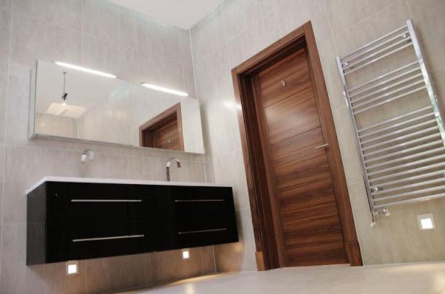 Walnut door set in bathroom