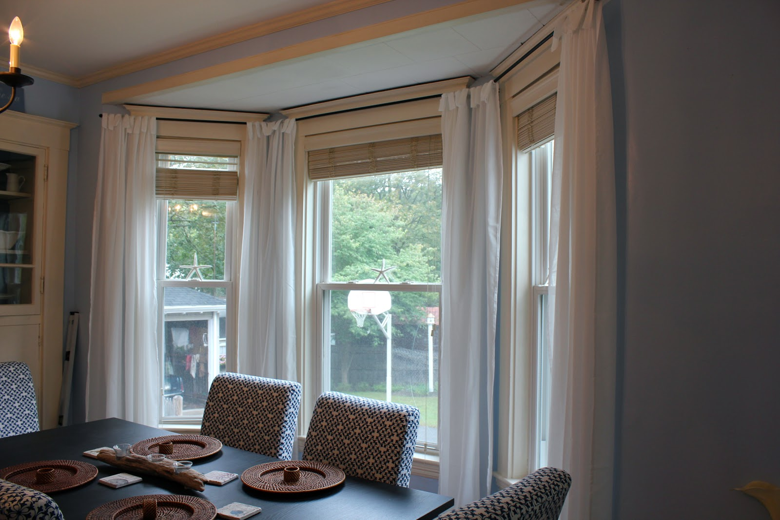 Our cottage on the coast make your own bay window treatment for Window dressing