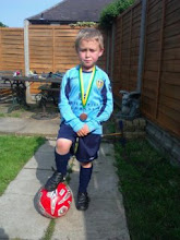 Bobby with his medal in his new LUFC kit