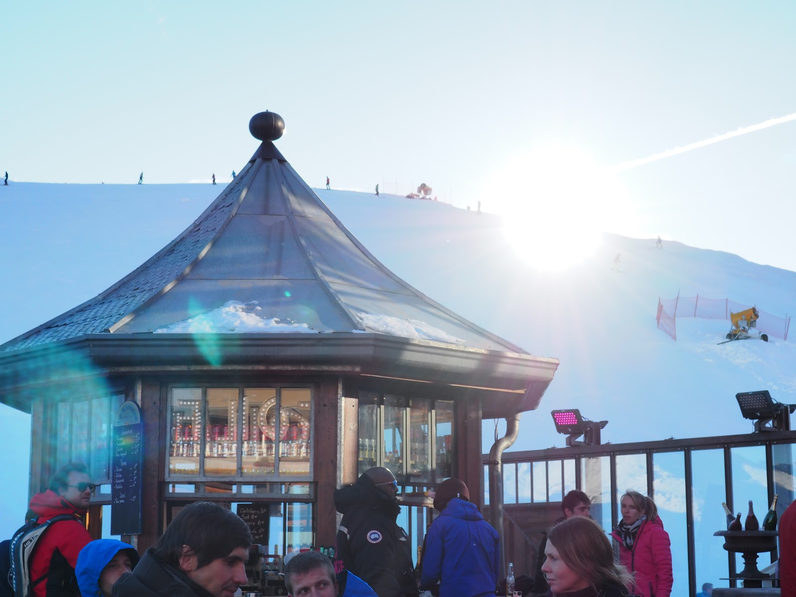 sun setting behind mountain, La Folie Douce, Val d'Isere, France