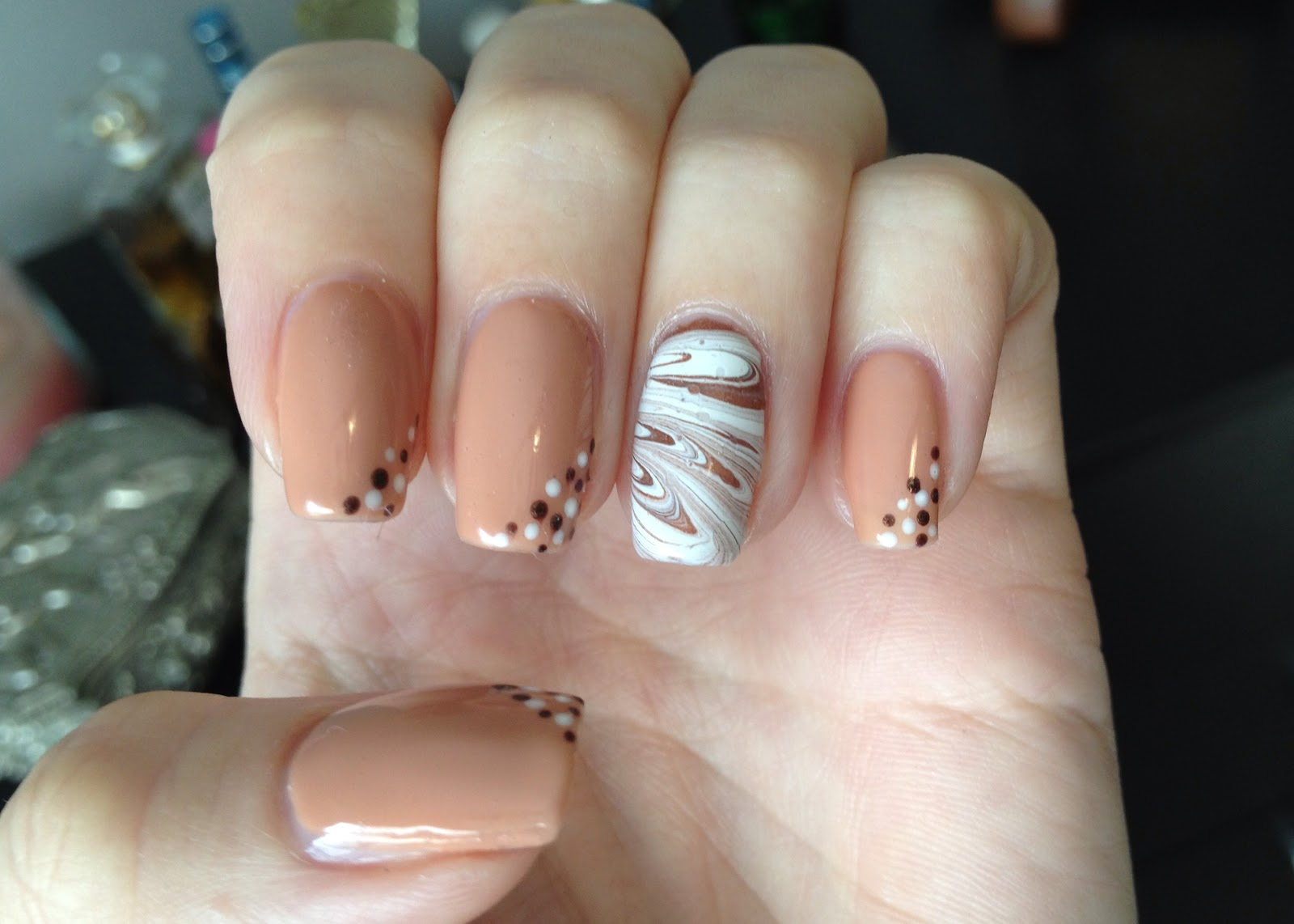 Shellac Cocoa with water marble accent nail.