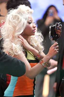 Nicki Minaj holding cute Hello Kitty hand held looking glass mirror