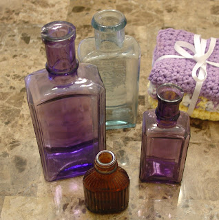 four antique medicine bottles Vicky bought at the Cameron Antiques Street Fair