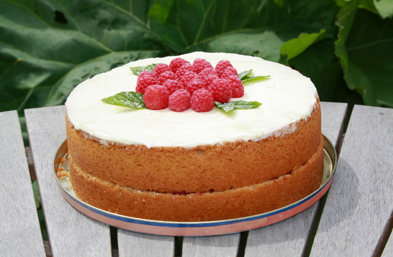 Lemon and raspberry Madeira cake topped with lemon buttercream and raspberries