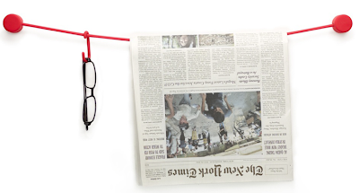 wall-mounted line with hooks - holds eyeglasses, newspaper, etc.