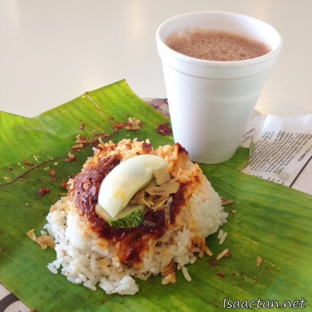 My rather yummy free Nasi Lemak with hot Milo for breakfast that morning.