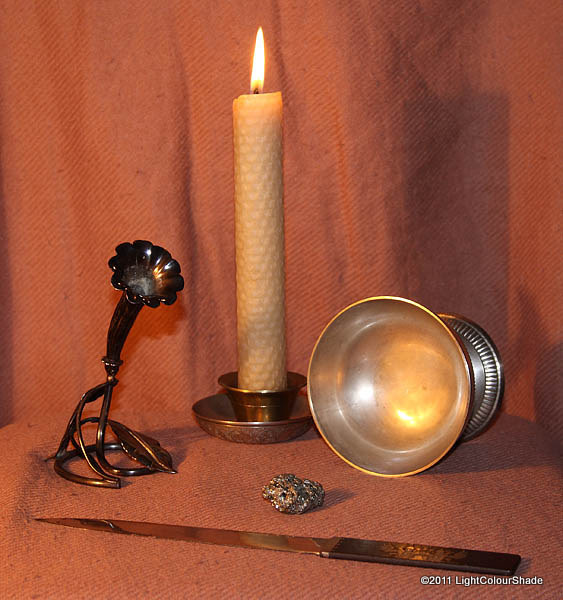 Still life with honeycomb candle and paperknife