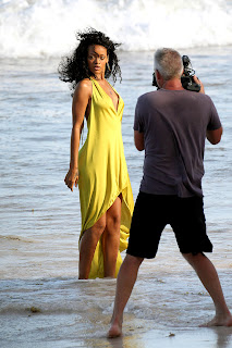 Rihanna posing in a yellow dress for a new photoshoot
