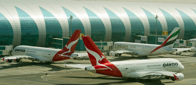 Emirates and Qantas A380s parked at Concourse A, Dubai International Airport