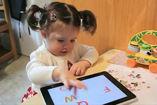 image of child with iPad