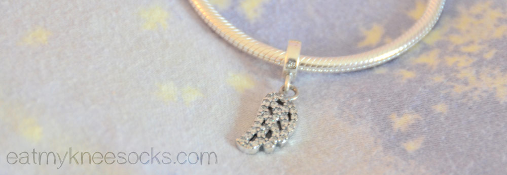 The dangling silver leaf/wing charm from Soufeel, a Pandora-like store.