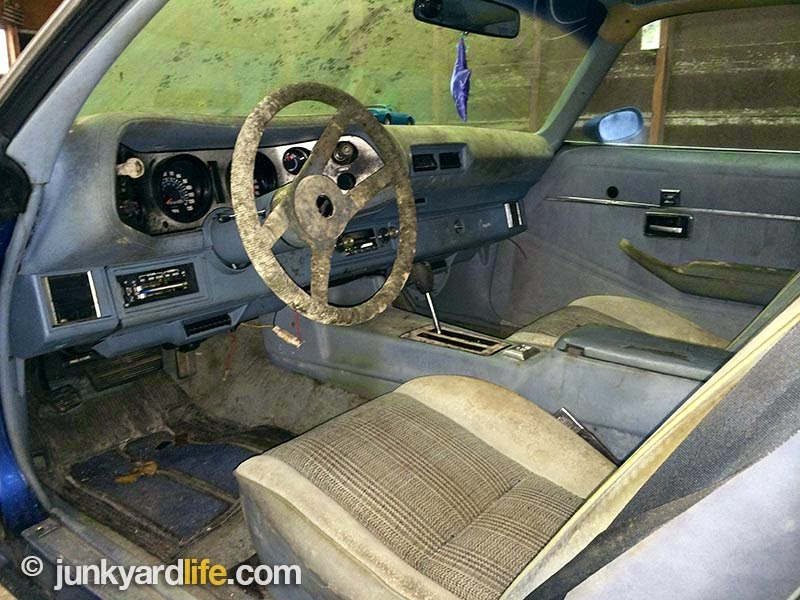 Sit down in the standard blue cloth seats on this 1978 Camro Z28 barn find.