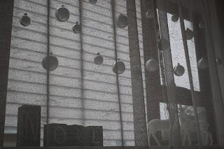 A close up shot of the window, showing blocks sitting on the windowsill.