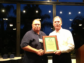 Rocky Ponders accepting the award for Recycler of the Year for Columbia Recycling