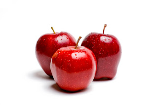 Three red apples