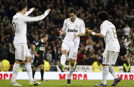 Ángel di María celebrates a goal against Racing Santander with his Real Madrid team-mates