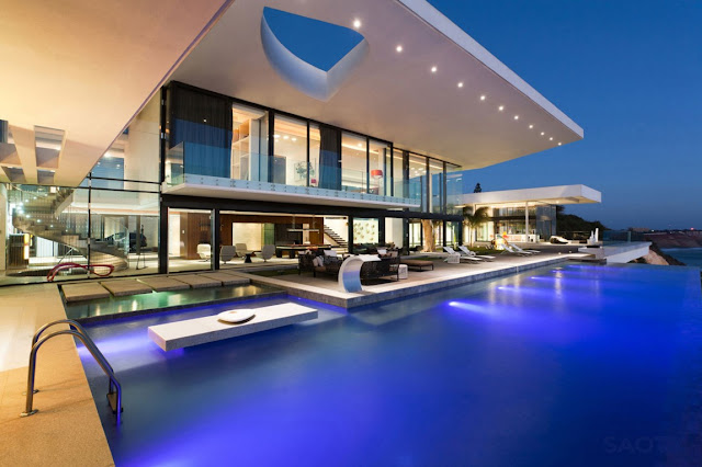 Picture of a dream home at sunset as seen from the pool area