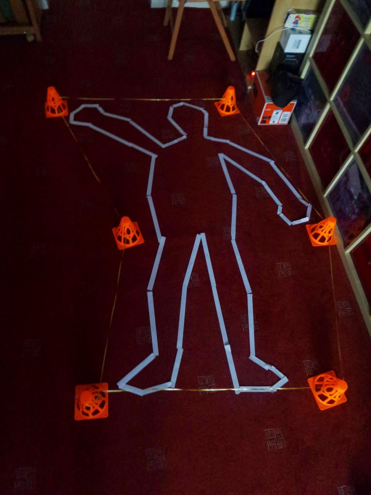 Either the outline of a Dead Body or someone doing Saturday Night Fever